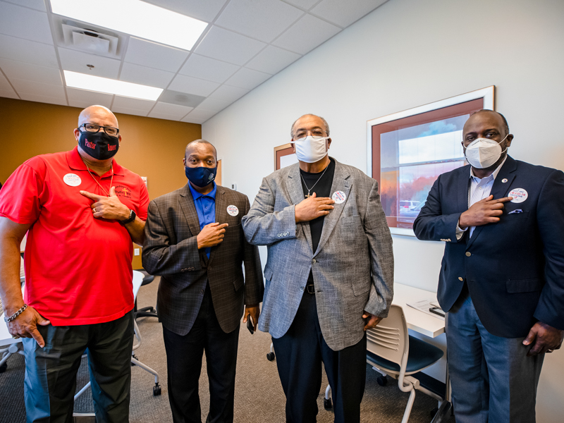 "Showing off their ""I got my COVID-19 vaccine"" stickers, are, from left, pastors Keith Rouser, Tony Montgomery, Earnest Ward and Reginald Buckley."