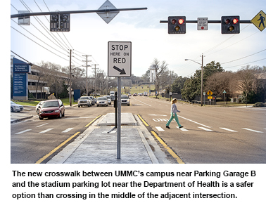 The new crosswalk between UMMC's campus near Parking Garage B and the stadium parking lot near the Department of Health is a safer option than crossing in the middle of the adjacent intersection.