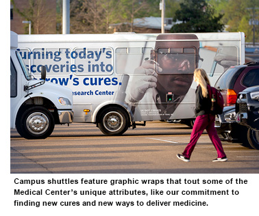 UMMC Bus displaying Male African-American Student