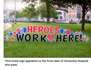 "A sign that reads ""Heroes Work Here!"" in the front entrance fo UMMC Adult Hospital that encouraged workers during Coronavirus Pandemic."