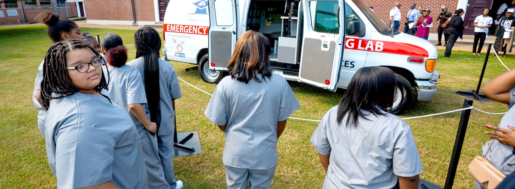 Lanier high school students stand in line to see a retired ambulance that was refitted to serve as a stationary simulation lab.