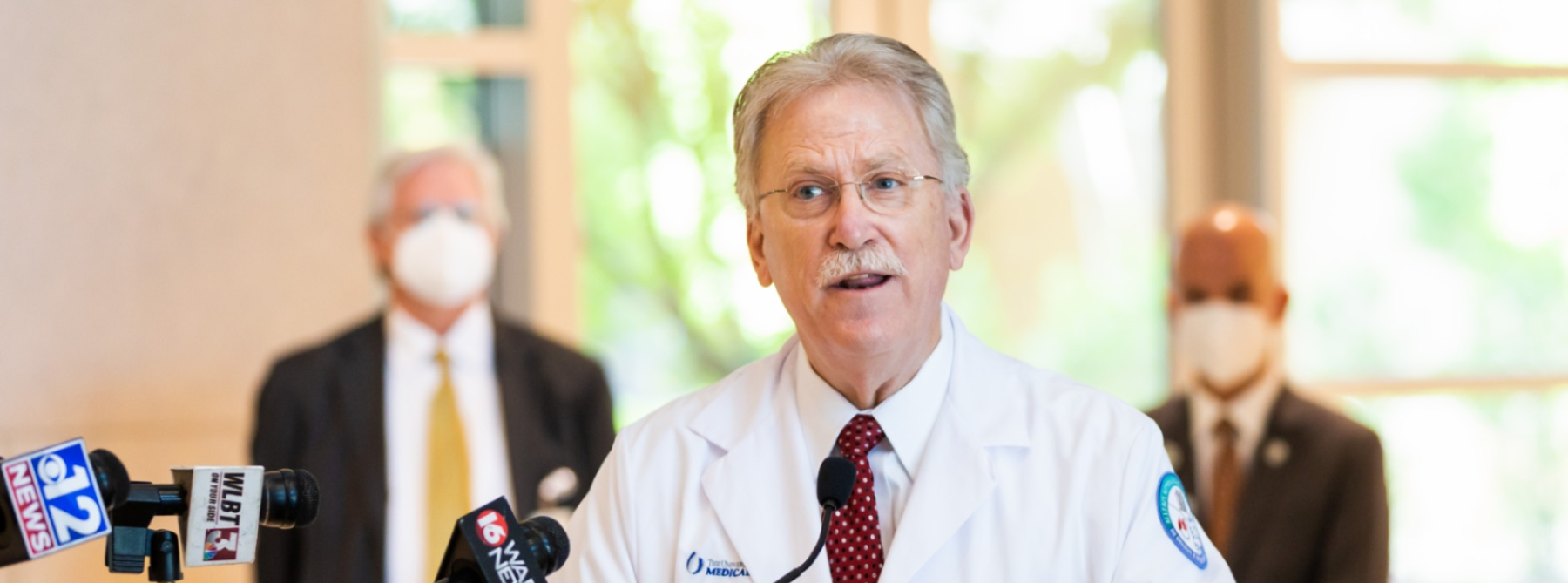 Dr. Marshall speaks at a press conference.