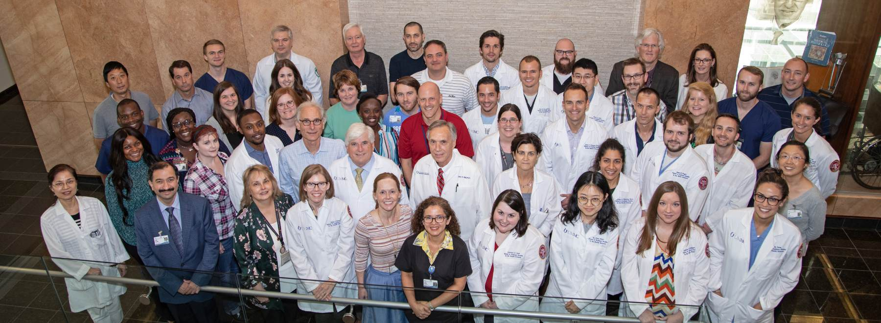 Group photo of physicians in white coats