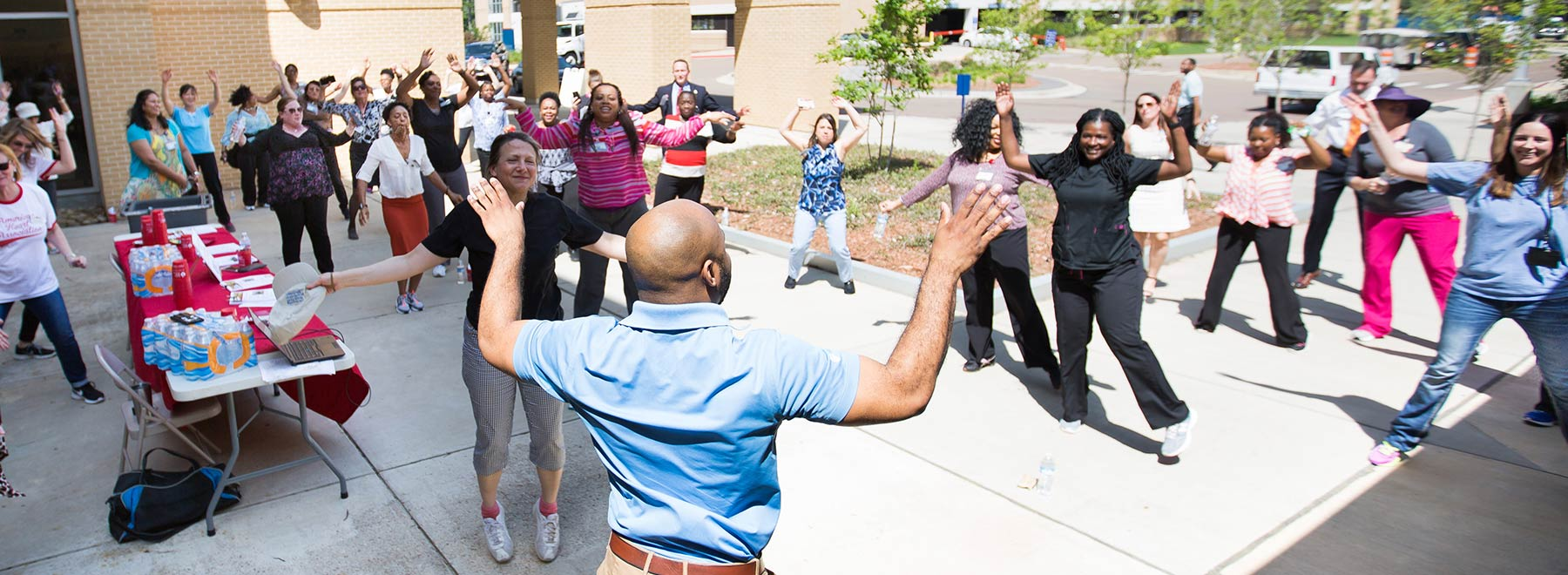 Educator leads a group in outdoor exercise